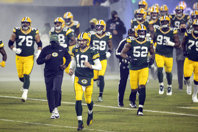 FILE - In this Dec 19. 2020, file photo, Green Bay Packers' Aaron Rodgers(12) runs out with teammates during an NFL football game against the Carolina Panthers in Green Bay, Wis. After a tumultuous offseason in which his future with the Packers appeared in doubt, reigning MVP Aaron Rodgers is ready to begin his 17th – and perhaps final – season in Green Bay.  (AP Photo/Jeffrey Phelp, File)