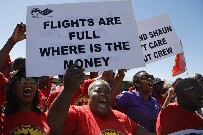 FILE — In this Friday, Nov. 15, 2019 file photo, members of the South African Cabin Crew Association and the National Union of Metalworkers of South Africa members picket at the SAA Airways Park in Kempton Park, South Africa. South Africa's troubled state-owned airline says flights will resume as normal over the weekend after it reached a deal with unions to end a week-long strike. South African Airways on Friday, Nov. 22 says it reached an agreement with the South African Cabin Crew Association and the National Union of Metalworkers of South Africa.(AP Photo/Themba Hadebe, File)