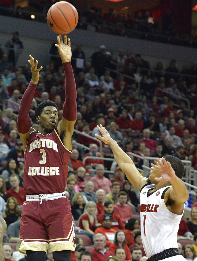 Boston College guard Jared Hamilton (3) shoots over the reach of Louisville guard Christen Cunningham (1) during the first half of an NCAA college basketball game in Louisville, Ky., Wednesday, Jan. 16, 2019. (AP Photo/Timothy D. Easley)