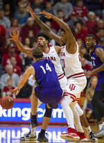 North Alabama's Payton Youngblood (14) is double-teamed by Indiana's Justin Smith (3), center, and De'Ron Davis (20) during the first half of an NCAA college basketball game, Tuesday, Nov. 12, 2019, in Bloomington, Ind. (AP Photo/Doug McSchooler)