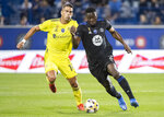 CF Montreal's Victor Wanyama (2) challenges Nashville SC's Daniel Rios during the first half of an MLS soccer match Saturday, Sept. 11, 2021, in Montreal. (Graham Hughes/The Canadian Press via AP)
