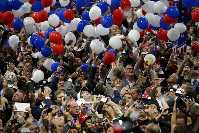 "FILE - In this July 21, 2016, file photo, confetti and balloons fall during celebrations after Republican presidential candidate Donald Trump's acceptance speech on the final day of the Republican National Convention in Cleveland. President Donald Trump demanded Monday, May 25, 2020, that North Carolina's Democratic governor sign off ""immediately"" on allowing the Republican National Convention to move forward in August with full attendance despite the ongoing COVID-19 pandemic. Trump's tweets Monday about the RNC, planned for Charlotte, come just two days after the North Carolina recorded its largest daily increase in positive cases yet. (AP Photo/Matt Rourke, File)"