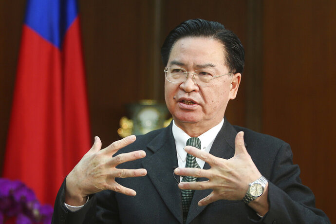 Taiwanese Foreign Minister Joseph Wu gestures while speaking during an exclusive interview with The Associated Press at his ministry in Taipei, Taiwan, Tuesday, Dec. 10, 2019. Wu was careful to say his government has no desire to intervene in Hong Kong's internal affairs, and that existing legislation is sufficient to deal with a relatively small number of Hong Kong students or others who seek to reside in Taiwan. (AP Photo/Chiang Ying-ying)