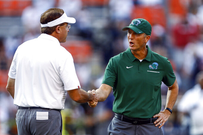 Auburn coach Gus Malzahn, left, and Tulane coach Willie Fritz shake hands before an NCAA college football game Saturday, Sept. 7, 2019, in Auburn, Ala. (AP Photo/Butch Dill)