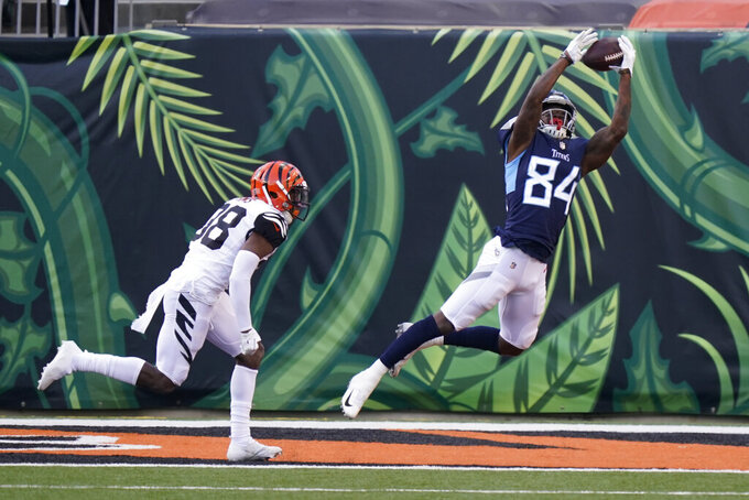 Tennessee Titans' Corey Davis (84) makes a touchdown reception against Cincinnati Bengals' LeShaun Sims (38) during the second half of an NFL football game, Sunday, Nov. 1, 2020, in Cincinnati. (AP Photo/Bryan Woolston)