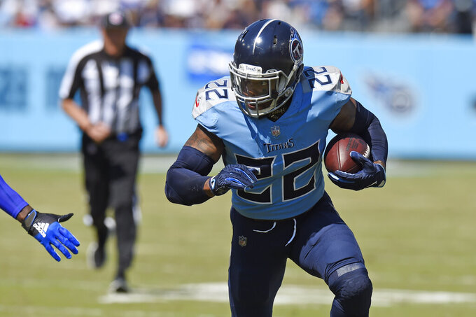 Tennessee Titans running back Derrick Henry (22) carries the ball against the Indianapolis Colts in the first half of an NFL football game Sunday, Sept. 26, 2021, in Nashville, Tenn. (AP Photo/Mark Zaleski)