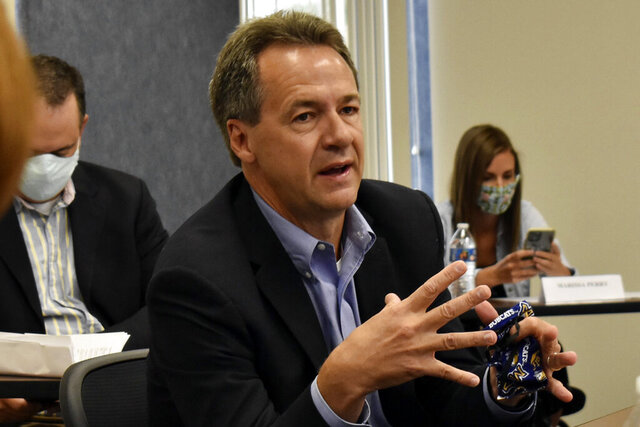 Montana Gov. Steve Bullock speaks to members of the business community in Billings, Mont., on July 24, 2020. The Democratic governor is asking a federal judge to oust the Trump administration official responsible for overseeing more than quarter-billion acres of public lands. (AP Photo/Matthew Brown)