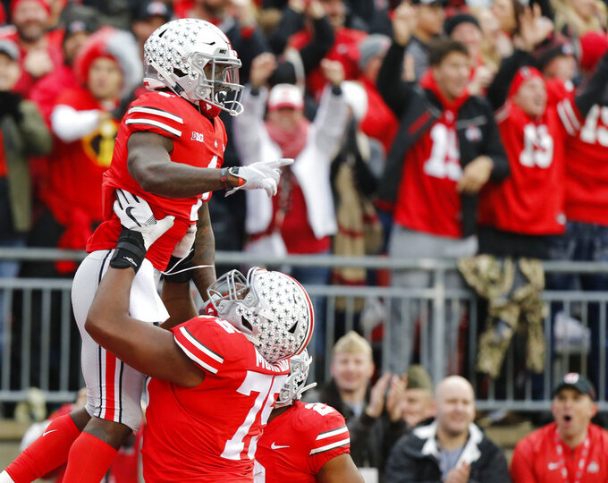 Ohio State receiver Johnnie Dixon, top, celebrates his touchdown against Michigan during the first half of an NCAA college football game Saturday, Nov. 24, 2018, in Columbus, Ohio. (AP Photo/Jay LaPrete)