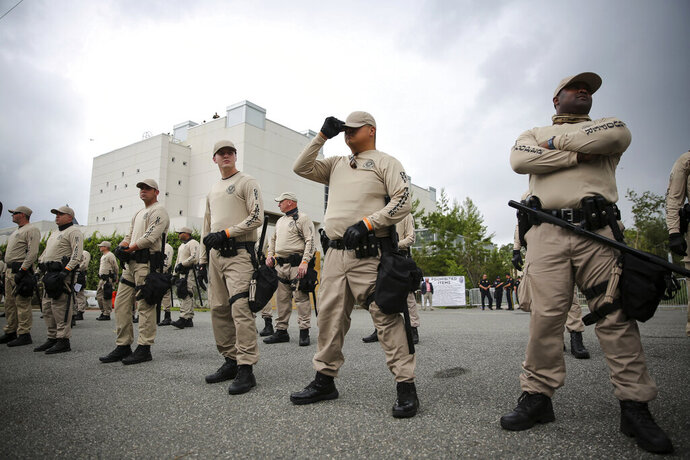 In this Oct. 19, 2017 photo, Troopers with the Florida Highway Patrol Quick Response Force line in front of the Phillips Center on the University of Florida campus in Gainesville, Fla.,  ahead of white nationalist Richard Spencer's speech,  White supremacist propaganda circulated on college campuses nearly doubled in 2019, according to a report by the Anti-Defamation League published Wednesday, Feb. 12, 2020.  (Will Vragovic/Tampa Bay Times via AP)