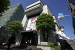 Tokyo Stock Exchange building is seen Friday, Oct. 2, 2020, in Tokyo. Tokyo's market resumed trading Friday after a full-day outage due to a malfunction in its computer systems. (AP Photo/Eugene Hoshiko)