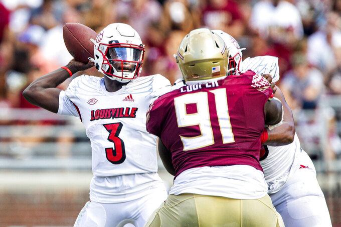 Louisville quarterback Malik Cunningham passes first half of an NCAA college football game against Florida State in Tallahassee, Fla., Saturday, Sept. 25, 2021. (AP Photo/Mark Wallheiser)