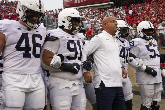 Penn State head coach James Franklin leads his team on the field before an NCAA college football game against Wisconsin Saturday, Sept. 4, 2021, in Madison, Wis. (AP Photo/Morry Gash)