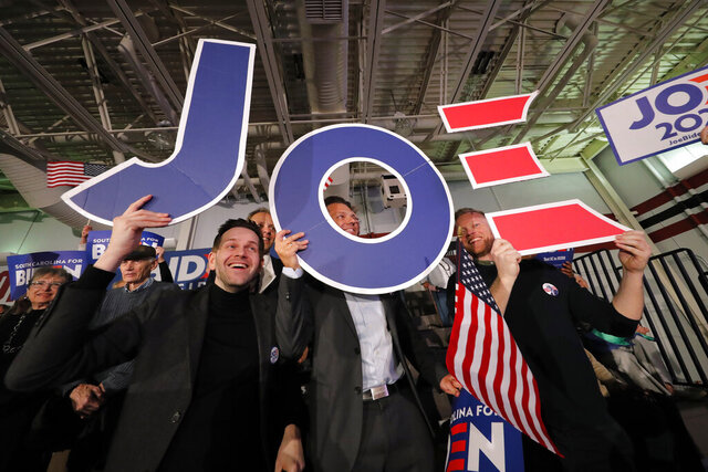 Supporters cheer at a primary election night rally for Democratic presidential candidate former Vice President Joe Biden in Columbia, S.C., Saturday, Feb. 29, 2020. (AP Photo/Gerald Herbert)