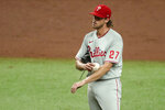 Philadelphia Phillies starting pitcher Aaron Nola reacts after giving up a single to Tampa Bay Rays' Hunter Renfroe to score the third Rays run during the third inning of a baseball game Sunday, Sept. 27, 2020, in St. Petersburg, Fla. (AP Photo/Mike Carlson)