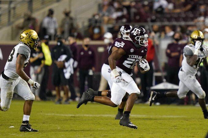 Texas A&M running back Isaiah Spiller (28) rushes for a first down against Vanderbilt during the second half of an NCAA college football game Saturday, Sept. 26, 2020, in College Station, Texas. Texas A&M won 17-12. (AP Photo/David J. Phillip)
