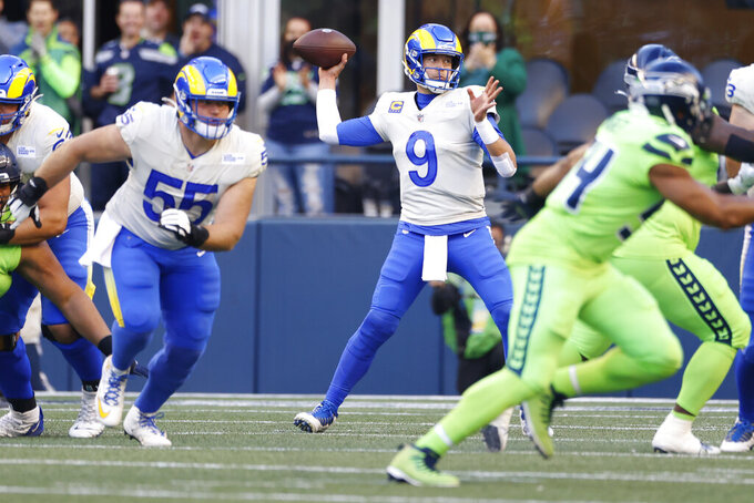 Los Angeles Rams quarterback Matthew Stafford (9) passes against the Seattle Seahawks during the first half of an NFL football game, Thursday, Oct. 7, 2021, in Seattle. (AP Photo/Craig Mitchelldyer)