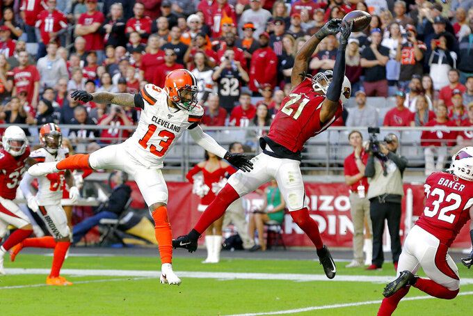 Arizona Cardinals cornerback Patrick Peterson (21) intercepts a pass in the end zone intended for Cleveland Browns wide receiver Odell Beckham (13) during the first half of an NFL football game, Sunday, Dec. 15, 2019, in Glendale, Ariz. (AP Photo/Rick Scuteri)