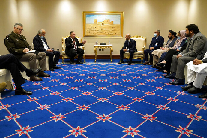 FILE - In this Nov. 21, 2020 file photo, Secretary of State Mike Pompeo, center left, and his aides meet with Afghanistan's State Minister for Peace Sayed Sadat Mansoor Naderi, center right, and the Islamic Republic of Afghanistan's peace negotiation team amid talks between the Afghan government and the Taliban, in Doha, Qatar. Afghan negotiators are to resume talks Tuesday, Jan. 5, 2021, even as hopes are waning, and frustration and fear is growing over a spike in violence that has combatants on both sides blaming the other. The change in the U.S. administration is likely to drag out the opening days of the talks as both sides wait to see whether Biden will stick to the deal brokered by Trump. (AP Photo/Patrick Semansky, Pool, File)