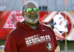 Florida State interim head coach Odell Haggins watches teams warm up before an NCAA college football game against Boston College, Saturday, Nov. 9, 2019, in Boston. (AP Photo/Bill Sikes)