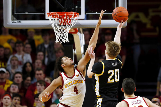 Southern Mississippi forward Hunter Dean (20) shoots over Iowa State forward George Conditt IV (4) during the first half of an NCAA college basketball game, Tuesday, Nov. 19, 2019, in Ames, Iowa. (AP Photo/Charlie Neibergall)