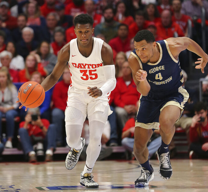Dayton's Dwayne Cohill (35) brings the ball upcourt against George Washington's Justin Williams (4) during the first half of an NCAA college basketball game Saturday, March 7, 2020, in Dayton, Ohio. (AP Photo/Tony Tribble)