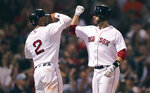 Boston Red Sox's J.D. Martinez, right, is congratulated by Xander Bogaerts after his two-run home run off Kansas City Royals starting pitcher Glenn Sparkman during the fourth inning of a baseball game at Fenway Park in Boston, Wednesday, Aug. 7, 2019. (AP Photo/Charles Krupa)
