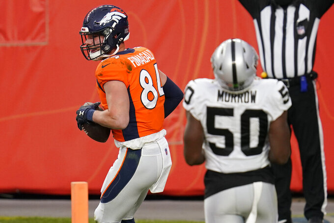 Denver Broncos tight end Troy Fumagalli (84) celebrates after scoring a touchdown against the Las Vegas Raiders during the first half of an NFL football game, Sunday, Jan. 3, 2021, in Denver. (AP Photo/David Zalubowski)