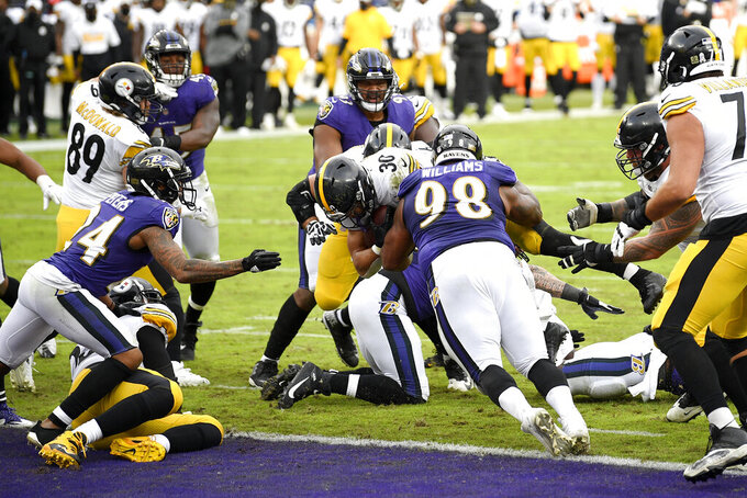 Pittsburgh Steelers running back James Conner (30) pushes in to score on a touchdown run against the Baltimore Ravens during the second half of an NFL football game, Sunday, Nov. 1, 2020, in Baltimore. (AP Photo/Nick Wass)
