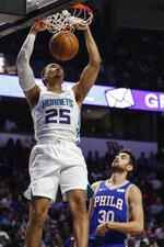 Charlotte Hornets forward PJ Washington (25) dunks over Philadelphia 76ers guard Furkan Korkmaz (30) in the second half of a preseason NBA basketball game in Winston-Salem, N.C., Friday, Oct. 11, 2019. (AP Photo/Nell Redmond)