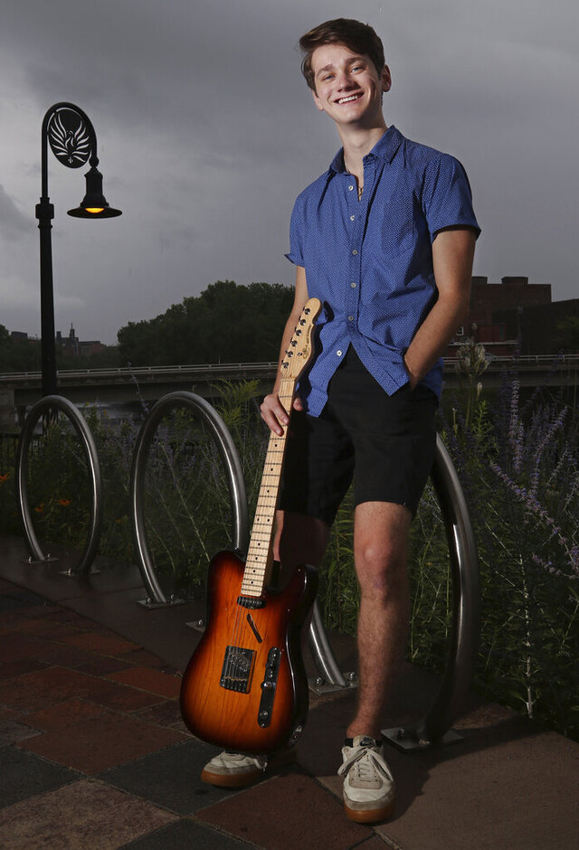 This July 21, 2020 photo shows Spencer Douglas of Eau Claire, Wis. Douglas has released two EPs, one of original music and another of cover songs, since last November. He also has displayed his talents in arts such as theater, choral music and improv. (Dan Reiland/The Eau Claire Leader-Telegram via AP)