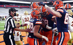 Syracuse tight end Aaron Hackett (89) celebrates his touchdown catch against Boston College with teammates during an NCAA college football game, Saturday, Nov. 7, 2020, at the Carrier Dome in Syracuse, N.Y. (Dennis Nett/The Post-Standard via AP)