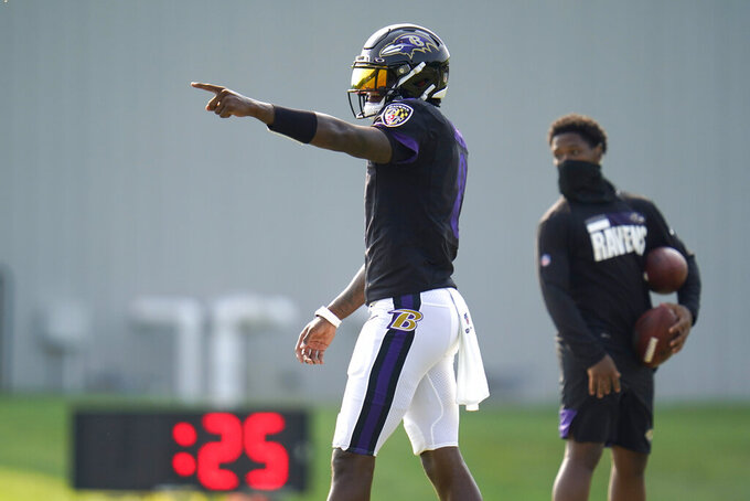 Baltimore Ravens quarterback Lamar Jackson reacts after running a drill during an NFL football training camp practice, Tuesday, Aug. 25, 2020, in Owings Mills, Md. (AP Photo/Julio Cortez)