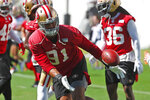 San Francisco 49ers defensive end Arik Armstead (91) warms up during practice, Thursday, Jan. 30, 2020, in Coral Gables, Fla., for the NFL Super Bowl 54 football game. (AP Photo/Wilfredo Lee)