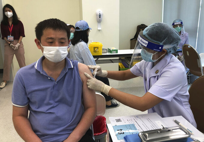 A health worker administers a dose of the Sinovac COVID-19 vaccine to Zhang Xiaohong, a 40-year-old businessman who runs a logistics company in Thailand, at Bangrak Vaccination & Health Center in Bangkok, Thailand Thursday, May 20, 2021. China began vaccinating its citizens living in Thailand on Thursday as part of a global campaign to inoculate its nationals living and working abroad. (AP Photo/Fu Ting)