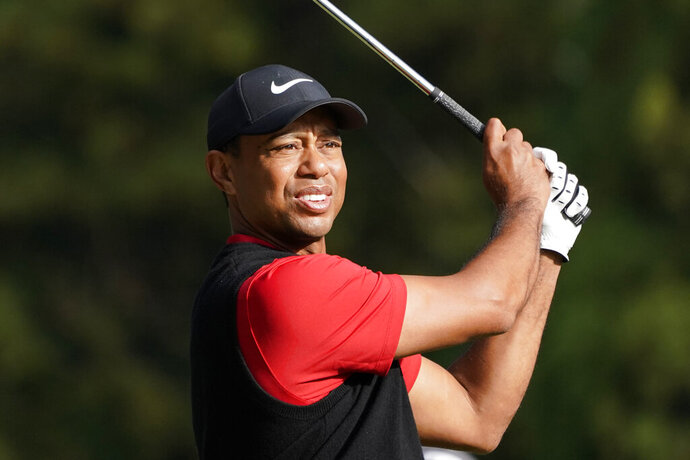 FILE - In this Monday, Oct. 28, 2019 file photo, Tiger Woods of the United States watches his tee shot on the 16th hole during the final round of the Zozo Championship PGA Tour at the Accordia Golf Narashino country club in Inzai, east of Tokyo, Japan. Woods is in the Bahamas this week as a player and a host, and in Australia next week as a player and Presidents Cup captain.(AP Photo/Lee Jin-man, File)