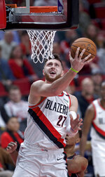 Portland Trail Blazers center Jusuf Nurkic scores during the first half of the team's NBA basketball game against the Chicago Bulls in Portland, Ore., Wednesday, Jan. 9, 2019. (AP Photo/Craig Mitchelldyer)