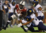 Oklahoma wide receiver Michael Woods II (8) is tackled by West Virginia cornerback Daryl Porter Jr. (2) and safety Sean Mahone (29) during the second half of an NCAA college football game in Norman, Okla., Saturday, Sept. 25, 2021. (AP Photo/Alonzo Adams)