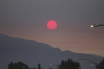 Smoke from wildfires burning east of Los Angeles dims the sunrise on Monday, Sept. 7, 2020, seen from Pasadena, Calif. The Bobcat Fire was burning near Cogswell Reservoir in the San Gabriel Mountains while the El Dorado Fire consumed thousands of acres of vegetation near the community of Yucaipa on the foothills of the San Bernardino Mountains. (AP Photo/John Antczak)