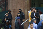 Venezuelan security officers block the entrance into the building where the offices of Venezuela's opposition leader Juan Guaido are located, in Caracas, Venezuela, Tuesday, Jan. 21, 2020. (AP Photo)