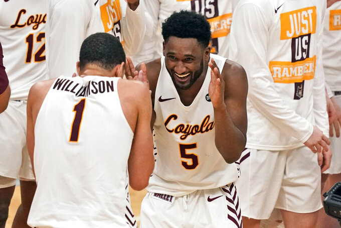 Loyola of Chicago's Keith Clemons (5) and teammate Lucas Williamson (1) celebrate following a 75-65 victory over Drake in the championship game of the NCAA Missouri Valley Conference men's basketball tournament Sunday, March 7, 2021, in St. Louis. (AP Photo/Jeff Roberson)