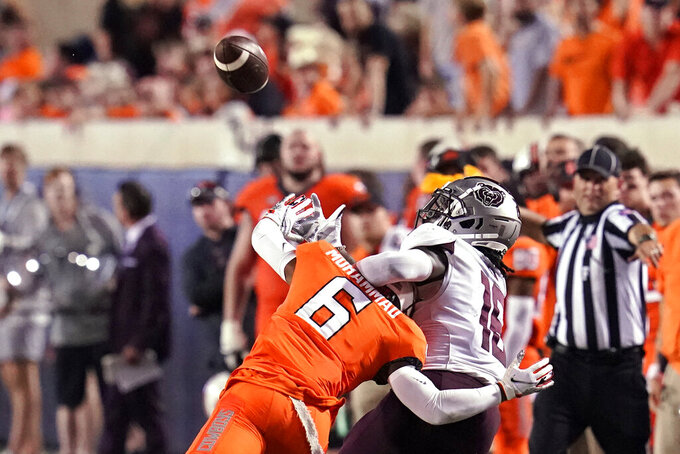 Oklahoma State cornerback Jabbar Muhammad (6) defends against a pass intended for Missouri State wide receiver Damoriea Vick (16) during the second half of an NCAA college football game, Saturday, Sept. 4, 2021, in Stillwater, Okla. Muhammad was called for pass interference. (AP Photo/Sue Ogrocki)