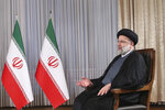 In this photo released by the official website of the office of the Iranian Presidency, President Ebrahim Raisi speaks in a live televised interview with state-run TV, at the presidency office in Tehran, Iran, Saturday, Sept. 4, 2021. (Iranian Presidency Office via AP)