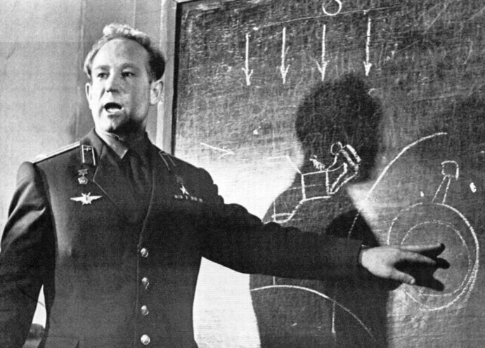 FILE - In this March 26, 1965 file photo, Cosmonaut Alexei Leonov, who stepped into space from the Voskod-2 spaceship, speaks in Moscow, Russia. Alexei Leonov, the first human to walk in space, died in Moscow on Friday, Oct. 11, 2019. He was 85. (AP Photo, File)