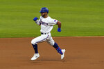 Texas Rangers' Leody Taveras sprints around second on his way to third after hitting a triple in the first inning of a baseball game against the Los Angeles Angels in Arlington, Texas, Thursday, Sept. 10, 2020. (AP Photo/Tony Gutierrez)