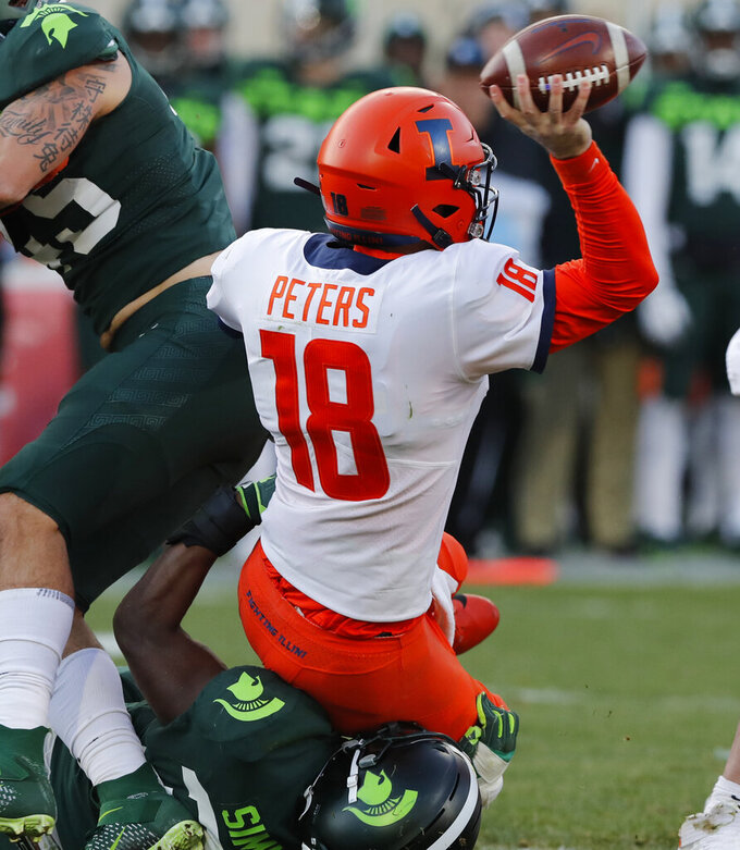 Michigan State linebacker Antjuan Simmons sacks Illinois quarterback Brandon Peters (18) during the first half of an NCAA college football game, Saturday, Nov. 9, 2019, in East Lansing, Mich. (AP Photo/Carlos Osorio)
