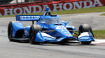 FILE - Alex Palou competes during an IndyCar race at Mid-Ohio Sports Car Course in Lexington, Ohio, in this Sunday, July 4, 2021, file photo. Only 62 points separate Palou and four other drivers with four races remaining and Palou was dealt his third pre-race penalty before he even arrived at Gateway. Honda has pulled the engine from Palou's car for a third time this season — twice this month — before a change was permitted under IndyCar rules. (AP Photo/Tom E. Puskar, File)