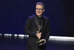 """FILE - John Oliver accepts the award for outstanding writing for a variety series for """"Last Week Tonight With John Oliver"""" at the 71st Primetime Emmy Awards on Sept. 22, 2019 in Los Angeles. Before hosting his own show, Oliver was a cast member on """"The Daily Show with John Stewart."""" (Photo by Chris Pizzello/Invision/AP, File)"""
