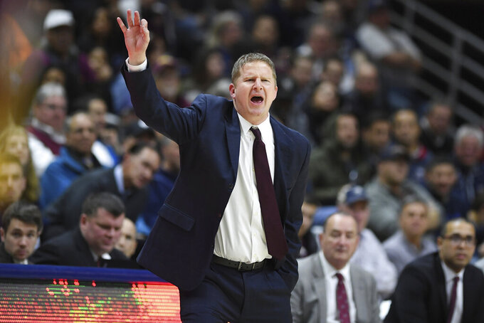 Iona associate head coach Tra Arnold calls out to his team the second half of an NCAA college basketball game against Connecticut, Wednesday, Dec. 4, 2019, in Storrs, Conn. (AP Photo/Jessica Hill)