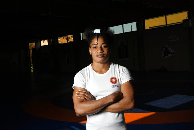 Guinean wrestler Fatoumata Yarie Camara poses for a portrait before the start of her afternoon training session in Ostia, near Rome, Monday, July 5, 2021. A West African wrestler's dream of competing in the Olympics has come down to a plane ticket. Fatoumata Yarie Camara is the only Guinean athlete to qualify for these Games. She was ready for Tokyo, but confusion over travel reigned for weeks. The 25-year-old and her family can't afford it. Guinean officials promised a ticket, but at the last minute announced a withdrawal from the Olympics over COVID-19 concerns. Under international pressure, Guinea reversed its decision.  (AP Photo/Alessandra Tarantino)