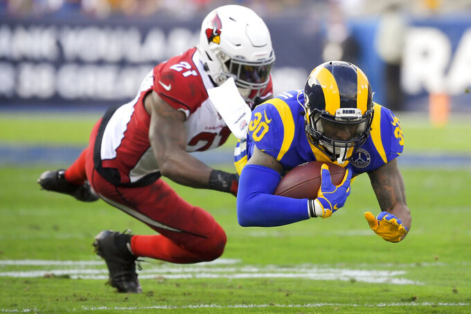 Los Angeles Rams running back Todd Gurley, right, is tackled by Arizona Cardinals cornerback Patrick Peterson during first half of an NFL football game Sunday, Dec. 29, 2019, in Los Angeles. (AP Photo/Mark J. Terrill)